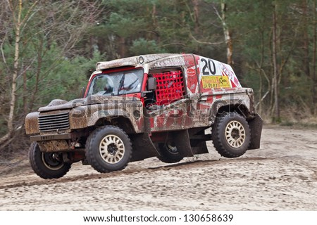 BORDON, UK - FEBRUARY 24: Driver Jim Lawrence takes his off road 4x4 Tomcat vehicle across a set of rollers at speed during round 1 of the SCOR Comp Safari event on February 24, 2013 in Bordon - stock photo