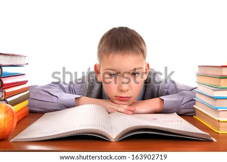 Bored and Tired Boy on the School Desk Isolated on the white background - stock photo