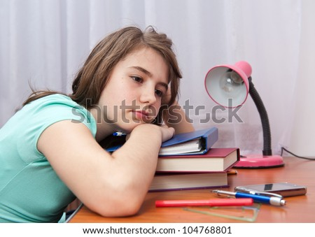 bored and tired student after hard work. Back to school concept - stock photo