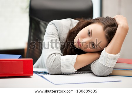 bored and tired woman behid the table - stock photo