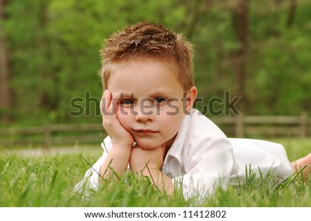Bored boy- tired of this photoshoot! - stock photo