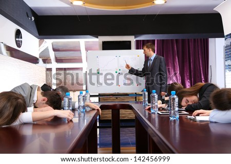 Bored business training at office - stock photo