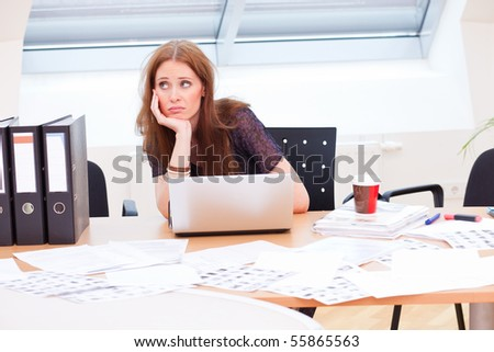 bored business woman is getting really tired - stock photo