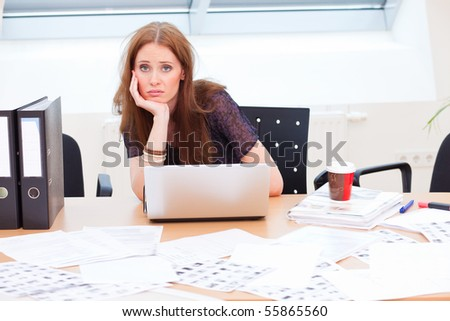 bored business woman is getting really tired from work - stock photo