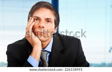 Bored businessman portrait - stock photo