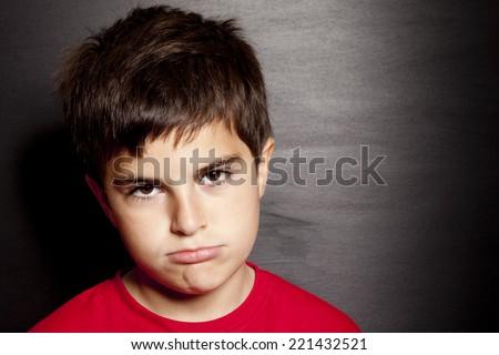 bored child on black background - stock photo