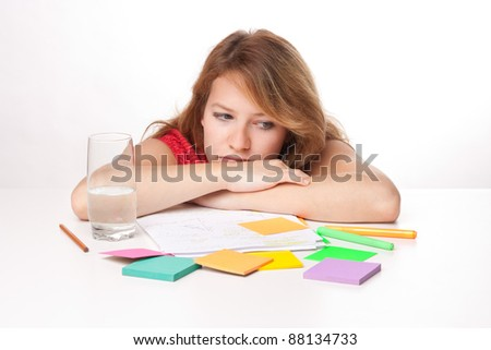 Bored college student is having a rest during studying for exam - stock photo