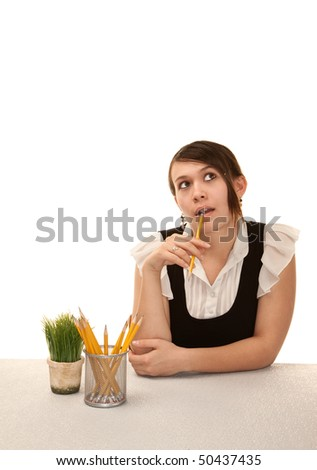 Bored female office worker at her desk - stock photo