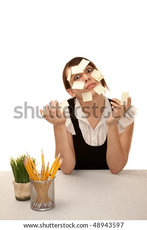 Bored female office worker at her desk with blank sticky notes - stock photo