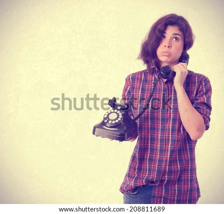 Bored girl talking by phone - stock photo