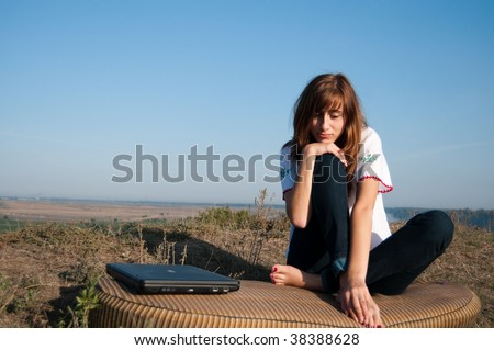 Bored Girl with laptop outdoor