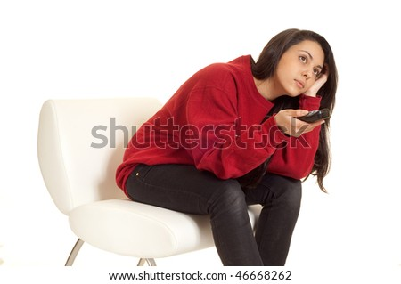bored girl with remote control - stock photo