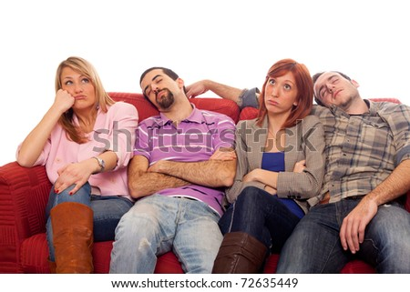 Bored Girls while Man Sleeping on Sofa - stock photo