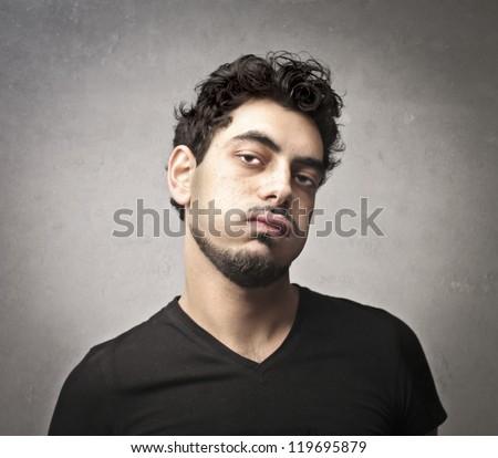 Bored guy snorting - stock photo
