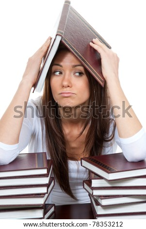 Bored High school or college girl reading student book getting ready for college classes on a white background - stock photo