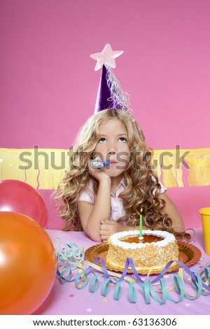 bored little blond girl in a birthday party with cake and candle on pink background - stock photo