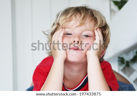 Bored little boy - stock photo