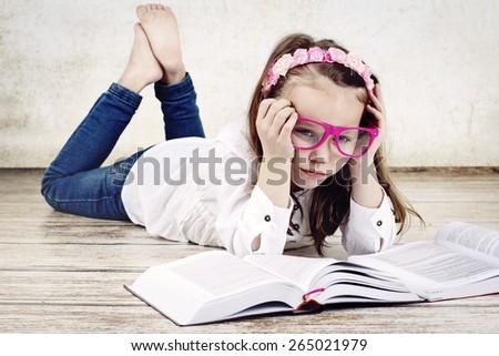 Bored little schoolgirl - stock photo