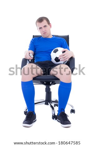 bored man in uniform with remote control watching soccer game isolated on white background - stock photo