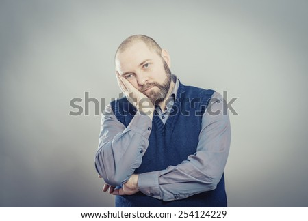 bored man over grey background - stock photo