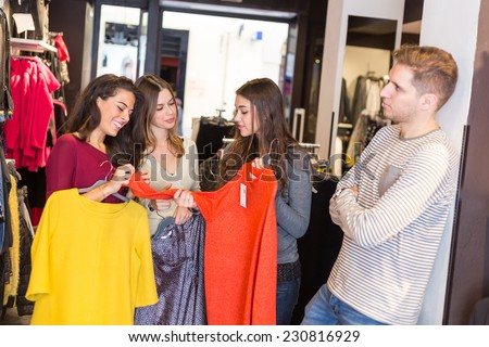 Bored Man Waiting for Women in a Clothing Store - stock photo