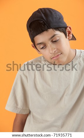 Bored Native American teenager on orange background - stock photo