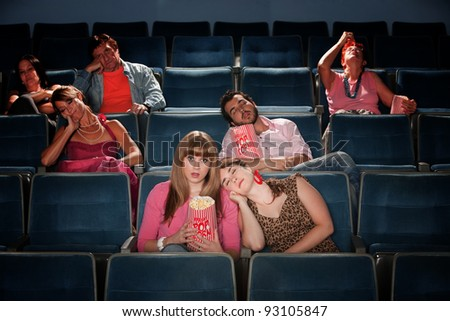 Bored people fall asleep in a theater