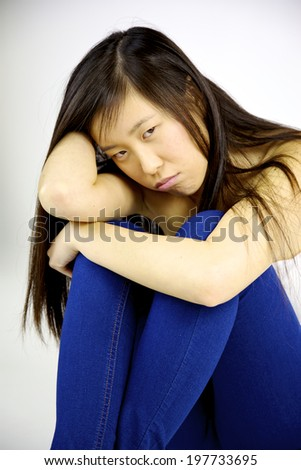 Bored sad asian woman feeling depressed