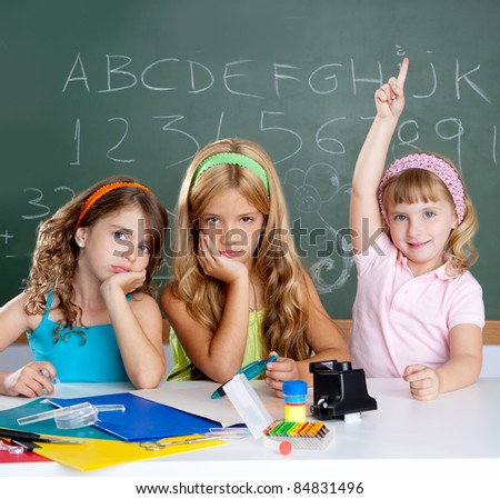 bored students with smart little girl raising hand finger at school