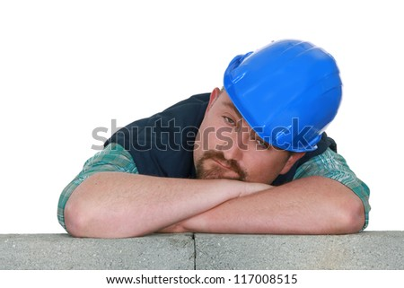 Bored tradesman at work - stock photo