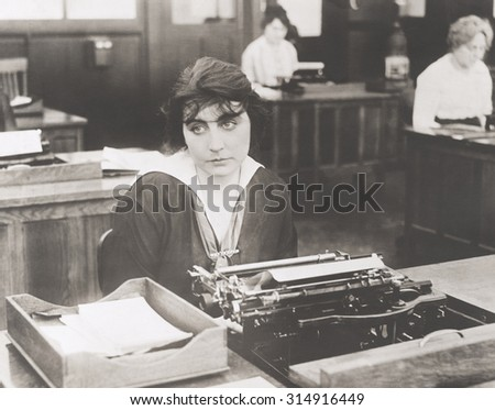 Bored typist - stock photo