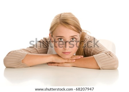 Bored woman behind desk - stock photo