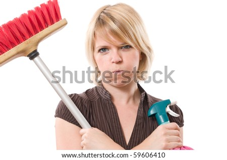 bored woman blows while making housework - stock photo