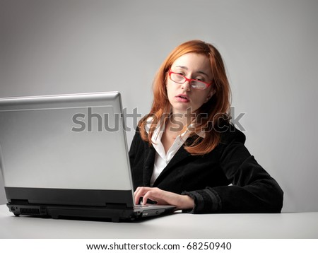 bored woman in office - stock photo