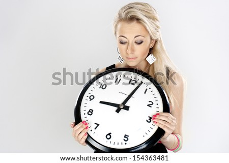 Bored woman looking at a clock