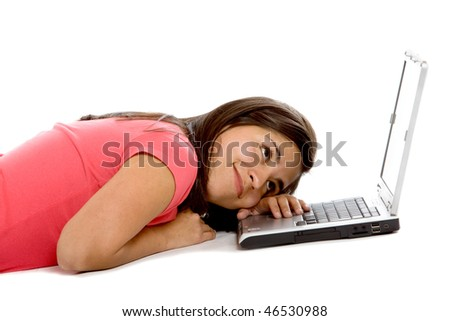 Bored woman lying on the floor with a laptop - isolated