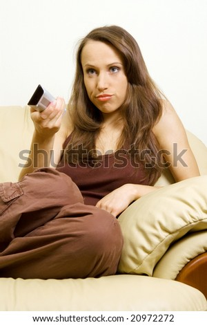 bored woman watching tv and there is nothing interesting - stock photo