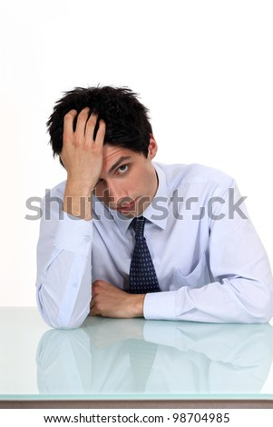 Bored young businessman - stock photo