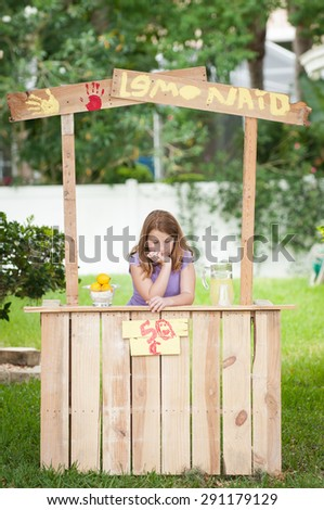 Bored young girl with no customers at her lemonade stand
