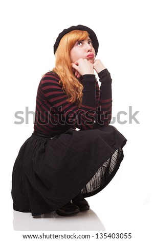 bored young woman sitting and looking up isolated on white background - stock photo