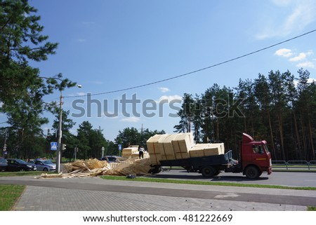 Borisov, Belarus - AUGUST 23, 2016: machine woodworking plant products overturned on a pedestrian crossing.