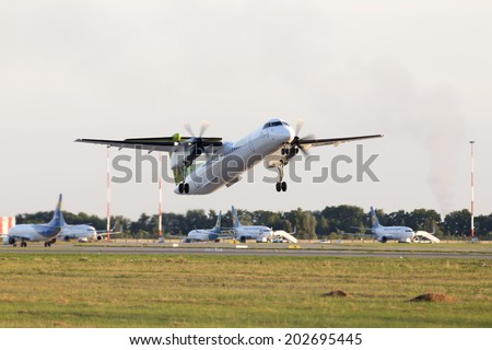 Borispol, Ukraine - June 28, 2014: airBaltic De Havilland Canada DHC-8-402Q Dash 8 aircraft departing from the Borispol International Airport on June 28, 2014.
