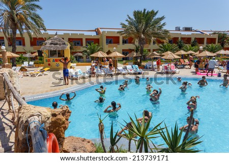 BORJ CEDRIA, TUNISIA - AUGUST 7: Tourists on holiday in an expensive hotel Carribean World are doing water aerobics in pool August 7, 2014 Borj Cedria, Tunisia.  - stock photo