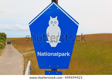 BORKUM, GERMANY - JUNE 11 2016: Sign of National park area on the island of Borkum in Niedersachsen. It marks the area as a quiet zone - stock photo