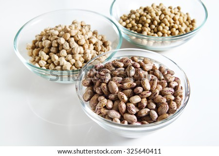 borlotti Beans in bowl and other Legumes on white - stock photo