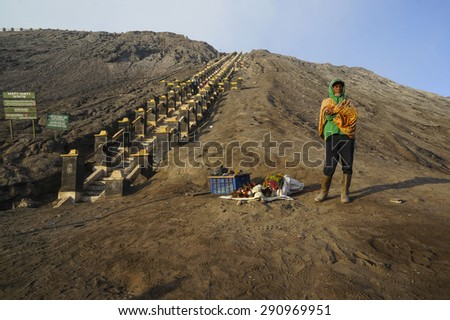BORMO - JUNE 14, 2015: Unidentified man selling flower for offering near the foot of Mount Bromo at Bromo Tengger Semeru National Park, Indonesia. - stock photo