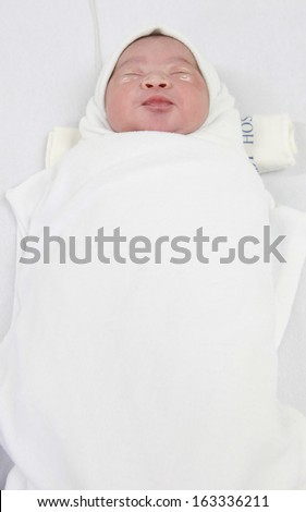 born baby boy sleeping in a room in the hospital after birth. - stock photo