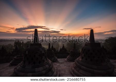 Borobudur Temple at sunrise, Yogyakarta, Java, Indonesia. (silhouette scene) - stock photo
