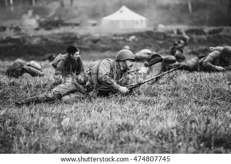 Borodino field, Moscow region, Russia - 12 October, 2014: Reenactment of the battle in WWII near the Borodino village in 1941, in Moscow region. Black and white photo.