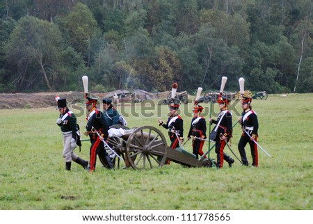 BORODINO, MOSCOW REGION - SEPTEMBER 02: Unidentified soldiers walking with cannon at Borodino historical reenactment at its 200th anniversary on September 02, 2012 in Borodino, Moscow Region, Russia.